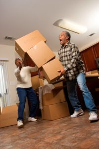 Image of seniors moving and packing